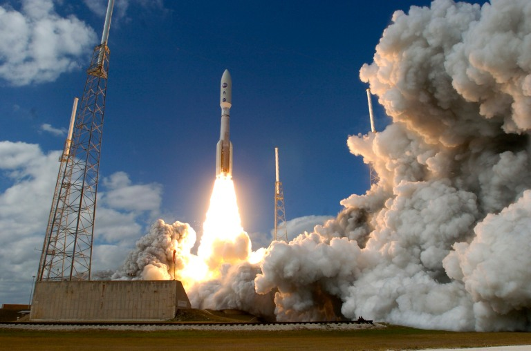 A Lockheed Martin Atlas V rocket carrying the New Horizons spacecraft lifts off from Launch Complex 41 at Cape Canaveral in Florida, Thursday, January 19, 2006. The New Horizons spacecraft is bound for the planet Pluto to map surface composition and temperatures, and examine Pluto's atmosphere. It will take 9 years for the spacecraft to reach the planet Pluto. (Photo by Red Huber/Orlando Sentinel/MCT via Getty Images)